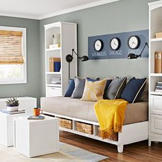 Give your guest room a more casual look with a platform bed featuring built-in cubbies. Finish the daybed look with a patterned pillow to make a traditional twin bed look and feel like a comfy couch. Freestanding closet units flanking the daybed provide chic display and practical storage. #daybedideas