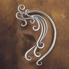 Sterling Silver Wind Earwrap  There's something of Botticelli and Titian in the grace of this ethereal earwrap: swirls of sterling silver, like the breath of celestial wind, whispering in your ear.