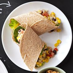 Easy Southwestern Veggie Wraps Recipe -I developed this recipe when corn was in the farmer's market and big, red, juicy tomatoes were in my garden. To make this wrap light and healthy, I use fat-free sour cream, whole grain tortillas and brown rice. Although it's vegetarian by nature, change it up with a large chicken breast, cut into small dice. —Cindy Beberman, Orland Park, Illinois