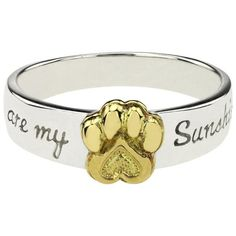 """Your pet is the light of your life. This sterling ring lets the world know with a brass paw print bracketed by the message """"You are my sunshine."""" sterling silver & brass W cm) Handmade in & fairly traded from Bolivia Snake Jewelry, Dog Jewelry, Animal Jewelry, Women Jewelry, Jewelry Rings, Glass Jewelry, Fashion Jewelry, Alternative Engagement Rings, Vintage Engagement Rings"""