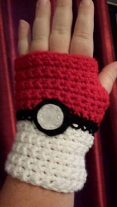 Pokemon pokeball inspired crochet fingerless gloves.  Www.Facebook.com/nerdyknits2013