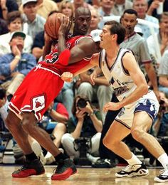 Michael jordan of the chicago bulls backs into jeff hornacek of the utah jazz during the Michael Jordan Basketball, Mike Jordan, Michael Jordan Photos, Jordan Bulls, Love And Basketball, Basketball Legends, Basketball Players, Basketball Skills, Jeff Hornacek