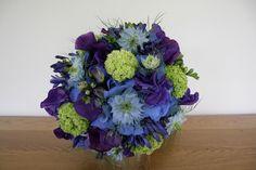 Purple lisianthus, blue nigella and guelder rose.