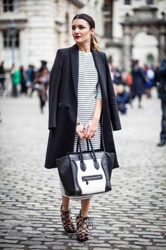 street-aesthetic:  Anisa Sojka Striped midi dress, black dress coat, lace up sandals, black and white celine tote