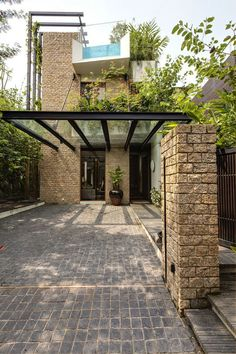 Wouldn't this be nice where the house meets the garage with a wood pergola instead of steel? Stone entrance facade