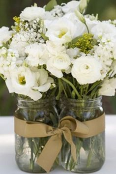 .multiple jars, one bouquet and a bow like a white or punch colored bow