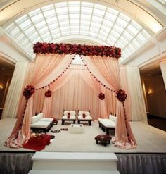 Elegant Peach Mandap for an indoor wedding