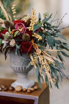 Marsala Flower Arrangement | Winter Wedding Inspiration | Cornwell Manor, Cotswolds | Chris Scuffins Photography | http://www.rockmywedding.co.uk/winter-romance-in-the-cotswolds/