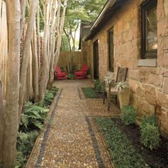 Maybe where the roses are now... Small Side Patio - The pebbled border adds texture in this cozy side-yard path and patio.