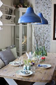 Rustic table with blue industrial lamps