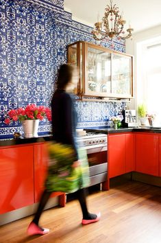 cobalt blue graphic wall + bright orange cabinets + glass gold wall single cabinet | via Simply Feminine. So Chic ~ Cityhaüs Design