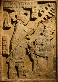 ::Yaxchilan_Lintel::. Bloodletting ritual ~ October 28, 709 The ruler, Shield Jaguar, holds a torch while his consort, Lady Xoc, pulls a rope studded with what are believed to be obsidian shards through her tongue in order to conjure a vision serpent.