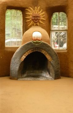 earthen floor and cob fireplace