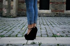 black wedge heels, with straps on them