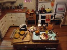 Since today is  Tablescape Thursday , I thought we would come back to   Kathleen's magical dollhouse and take a close look at some of h...
