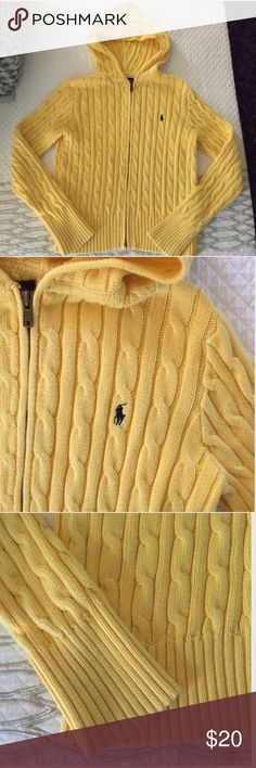 """Ralph Lauren cable knit hoodie This beautiful pale yellow hoodie is a go-to in any closet this fall! Wear it with your favorite pair of jeans and boots, or over a casual dress. Sized a L in kids, but will fit a ladies S. I'm a size 2 and 5'4"""" for reference. The hoodie is 20"""" overall length, and has stretch since it's cotton. Navy blue horse on front. Excellent condition! ✅reasonable offers ❌trades 💬ask questions 🛍bundle to save 👇🏼offer button Ralph Lauren Sweaters Cardigans"""