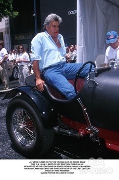Jay Leno Climbs Out of His Vintage Car on Rodeo Drive This Is a 1924 8 L. Bentley Hot Rod Twin Turbo 500 Hp He Arrived at the Concours on Rodeo, Beverly Hills, CA 6/18/2000 They Displayed 100 Cars, One For Each Year of the Last Century Photo by Nina Promm