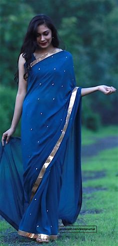 Pure silk georgette saree with sequins from eastandgrace.com