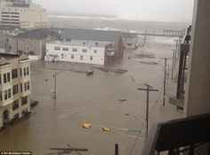 Boardwalk floating in sections through the flooded streets of Atlantic City' in New Jersey  posted by www.futons-direct.co.uk