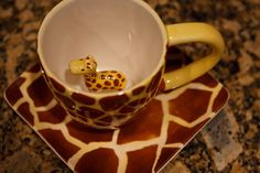 Pier One Imports: Ceramic Giraffe Mug! I love this cup--always a cute little surprise when you finish your drink! (Giraffe Mug by Caleb Keiter, via Flickr)