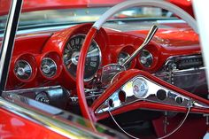 Red dashboard of a 1960 Chevrolet Impala ... wished there was still this much design imagination in today's boring, look-alike cars!