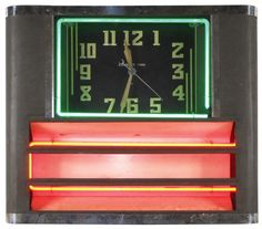 Say-It-In Neon clock, mfgd by Neon Clock Sales Co.