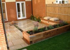 creative wood raised garden bed idea feat cool built in bench with brown cushions and brick house wall design