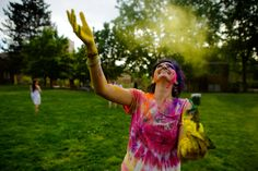 Graduate student Emily Hope Dobkin releases a cloud of colored flower into the air during the Hindu celebration of Holi on the Knight Library lawn. Holi Celebration, Knight, Rave, Clouds, Indian, Celebrities, Oregon, Emerald, Student