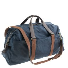 """J.crew. construction in rugged waxed cotton canvas with heavy-duty shoulder straps and extra reinforcements to help it withstand repeated use. <ul><li>8"""" handle drop.</li><li>17 1/2""""H x 26""""W x 9 1/4""""D.</li><li>Adjustable shoulder strap fully extends to 49 3/4"""".</li><li>Waxed cotton ..."""