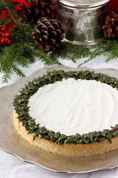 If you really need to impress Santa this year, wow him with this stunning sugar cookie cake, decorated to look just like a festive holiday wreath. It's surprisingly simple and so very delicious — you may never go back to baking regular cookies again! Sugar Cookie Cakes, Chocolate Chip Cookie Cake, Dessert Cake Recipes, Cookie Recipes, Green Food Coloring, Cake Plates, Holiday Festival, Festive, Giant Cookies