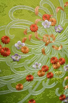 Japanese Embroidery using gold medal and silk threads.