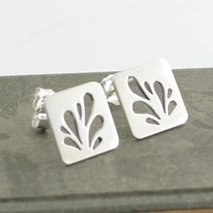Sterling silver droplet studs. $72