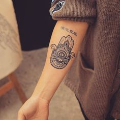Hamsa on forearm by Grain