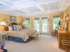 Traditional Master Bedroom with Waverly Bluebell BLUE YELLOW WHITE TOILE FLORAL, Carpet, Crown molding, Box ceiling
