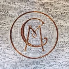 Club Monaco monogram tiled floor of Fifth Avenue and 22nd Street NYC store from http://instagram.com/p/ggbMkmEqfM/