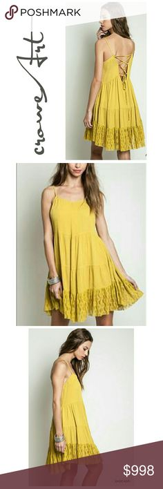 COMING SOON  Golden Strappy Trapeze Style Mini Avocado yellow Trapeze Style peasant mini dress,  lace accent hemline, tie back detail, perfect to bring in some warmer weather!  Price will be approx  $25  ***PLEASE MESSAGE ME TO BE TAGGED UPON ARRIVAL *** Boutique  Dresses Mini
