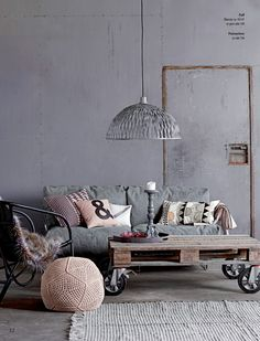 Living room - love the grey wall and pendant light