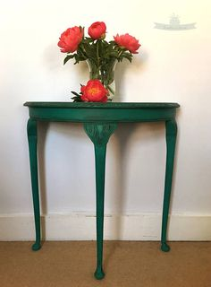 Gorgeous half moon console table painted with Annie Sloan Florence chalk paint. The detailing on tops of the legs and table rim has been darkened with wax which gives a sophisticated and beautiful finish. This Stunning piece of furniture would look great in any room displaying a loved lamp or favourite vase.  ~Measurements~  Height: 29.5 Width: 30 Depth: 14.5  Collection from TW20 area, can deliver locally for small charge or courier can be arranged but prices vary depending on mileage…