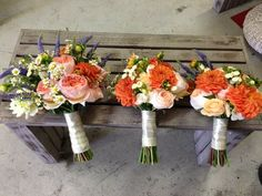 Orange bride and bridesmais's bouquet
