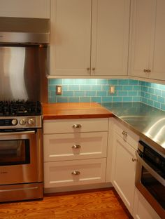 Kitchen Backsplash tile Aqua glass tile backsplash, subway tile backsplash. Found at https://www.subwaytileoutlet.com/