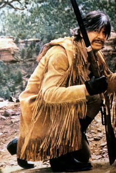 The US actor Charles Bronson kneeling with a gun in his hands in a scene of the film The White Buffalo directed by J Lee Thompson Bronson interprets. Actor Charles Bronson, Tombstone Movie, Western Film, Tough Guy, Hollywood Actor, Old West, Best Actor, Sexy Men, Westerns