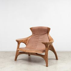 A recent design by Mendes, the Grude combines artisanal and contemporary carpentry techniques, in an ultra-comfortable, statement armchair. Translating to 'glued together', Mendes designed the Grude as a snug loveseat, as its name also refers to the numerous strips of laminated wood that comprise the design of the chair.