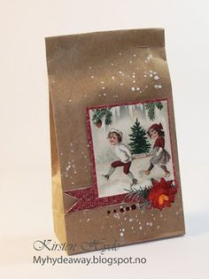 Mixed Media Kraft bag for an advent calendar. Created as a DT for Hobbykunst, This is made with papers from Papirdesign. Made by Kirsten Hyde.