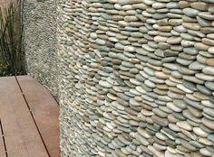 Sea Green standing pebble tile wall made of rocks.
