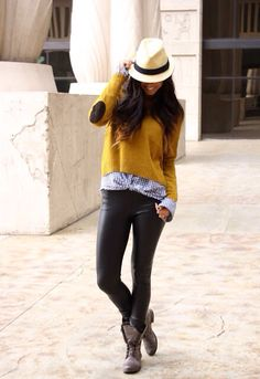 Mustard sweater with elbow patches, black leather leggings (or use coated skinny jeans), blue gingham button-up shirt, brown boots