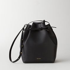 I'm not saying I'd carry a bucket bag, but if I did, this one by Mansur Gavriel is by far the chicest version I've found.