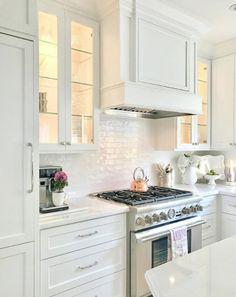 White Kitchen   white subway tile, backlit cabinets