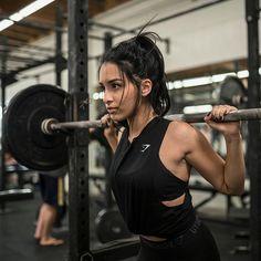 Black on black. Jasmine Garcia wears the Switch Back Vest to workout.