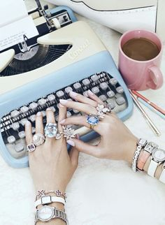 Typewriter! We've come a long way!....BTW, love the bling and coffee ;)