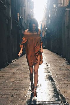 The model strolled along the streets of Barcelona wearing a breezy off-the-shoulder dress and lace-up heels that had us longing to a.) shop her closet and b.) catch the next flight to Spain. While a trans-Atlantic trip may not be in our immediate future, the outfit is—and on a budget at that. Jenner's marigold frock and strappy pumps are just $70 each at Mango.